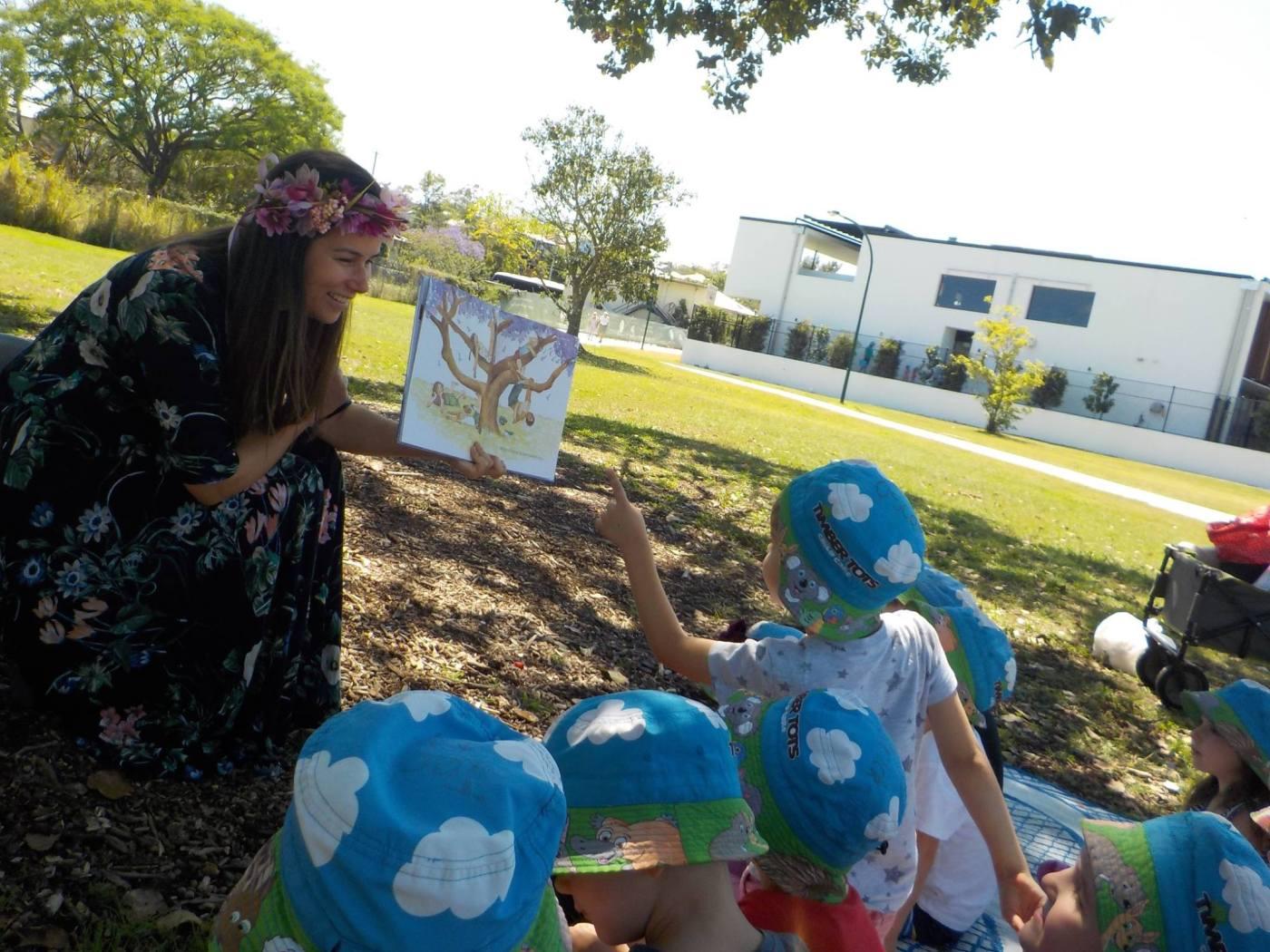 Author Dannika Patterson reading her picture book Jacaranda Magic to kindergarten children.